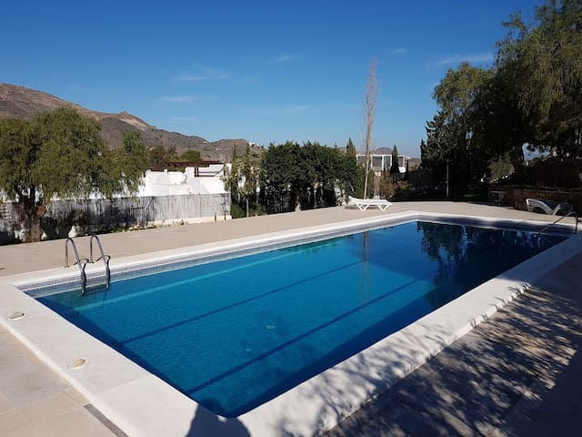 4 bedrooms, extensive private gardens, large pool