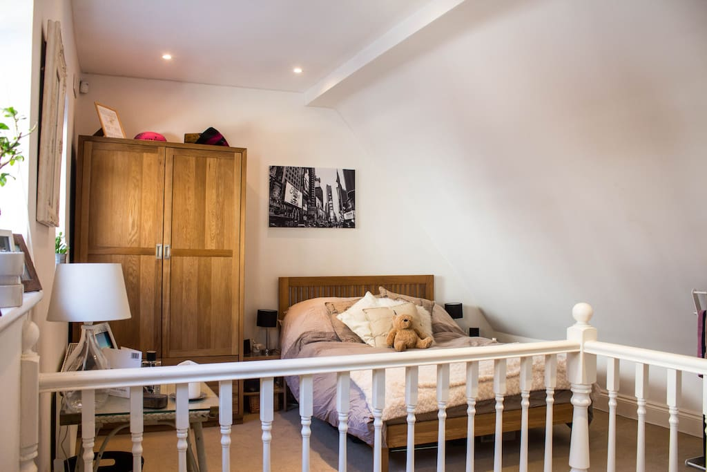 A very spacious double bedroom with two large windows which make the space very light and airy.