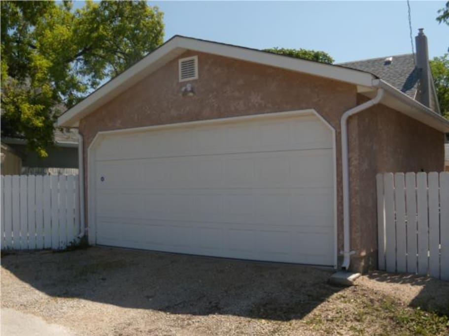 Double Garage (note fence in this picture has been upgraded to the brown one you see in the other outdoor photos)