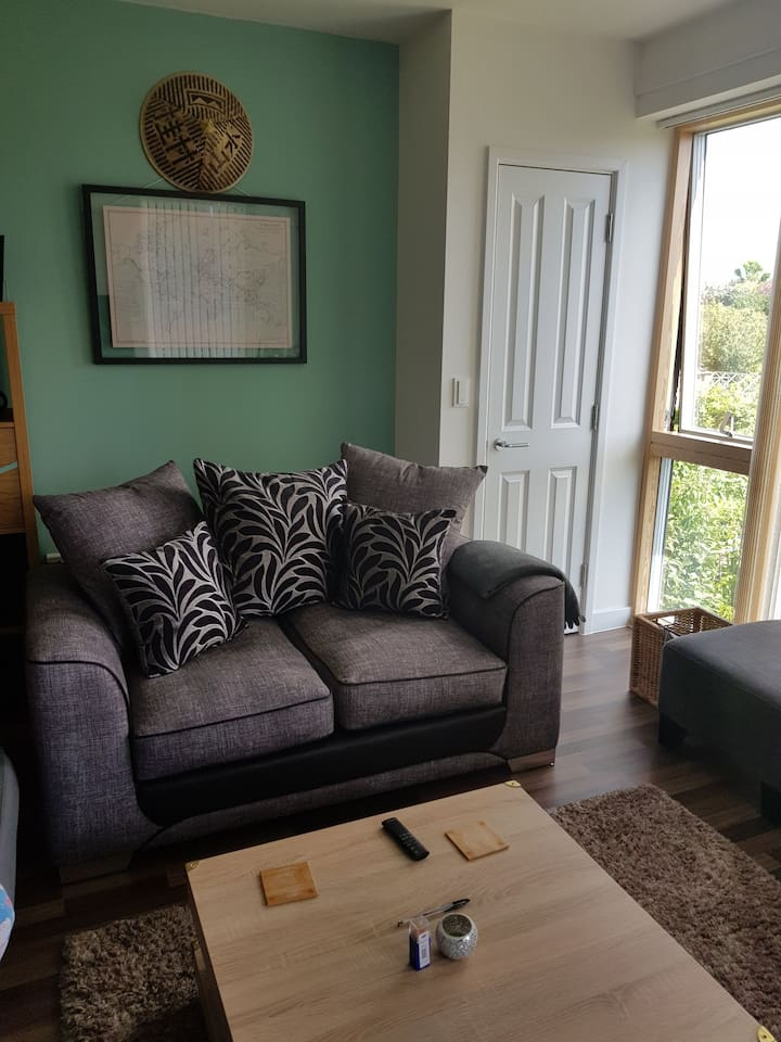 Living room with two-seater sofa