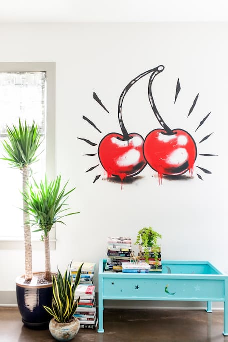 The perfect photo wall for your Instagram photos! Custom cherry art by Nashville artist Jeff Bertrand.