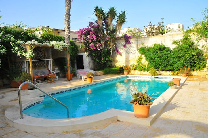 Large en-suite room in charming villa with pool