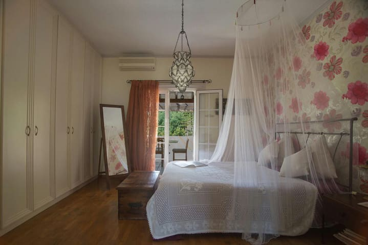 master bedroom with queen size bed and private balcony area and ensuite bathroom