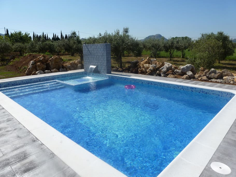 8m x 5m pool with 'waterfall' wall into children's pool