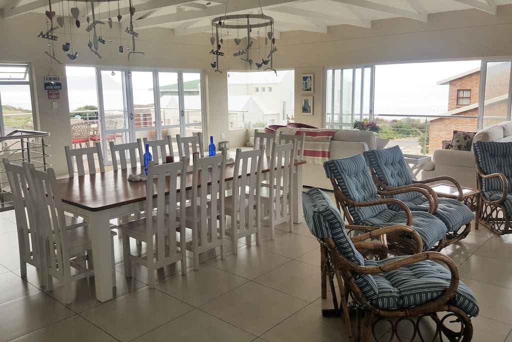 Open plan living, dining and barbecue area on upper level