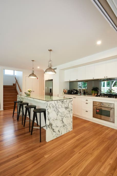 Gourmet kitchen with marble benchtop and European applicances.