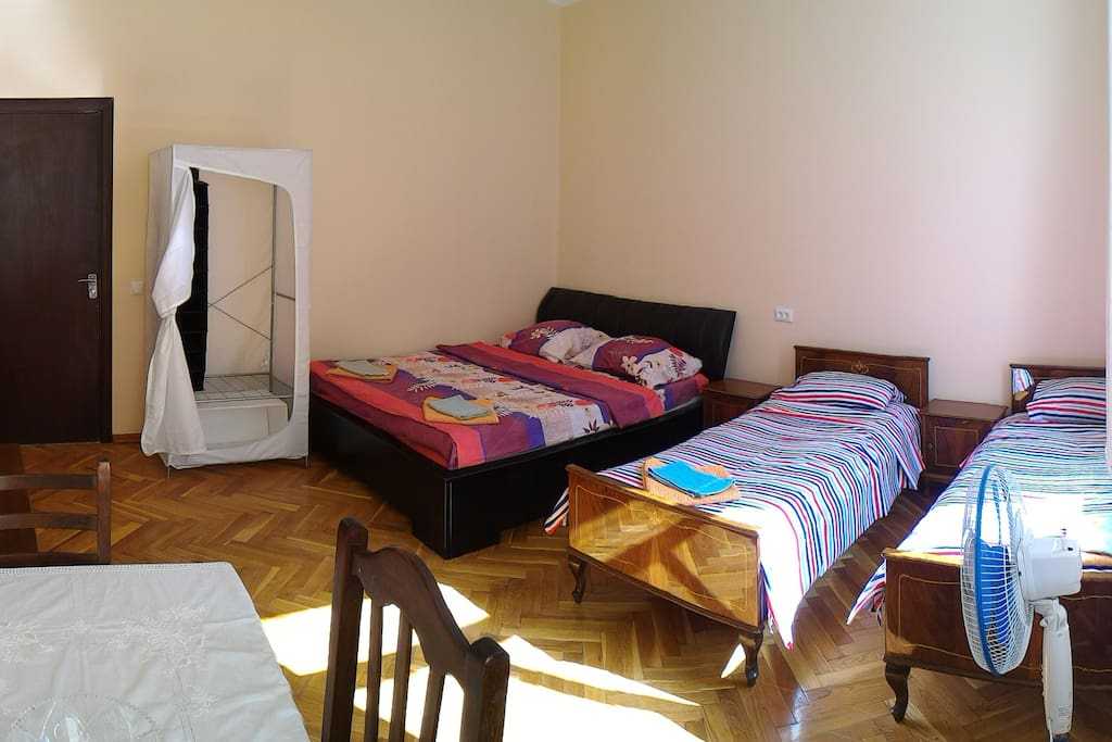Panorama of room with both the double and single beds. Could not orient the photo correctly on Airbnb.