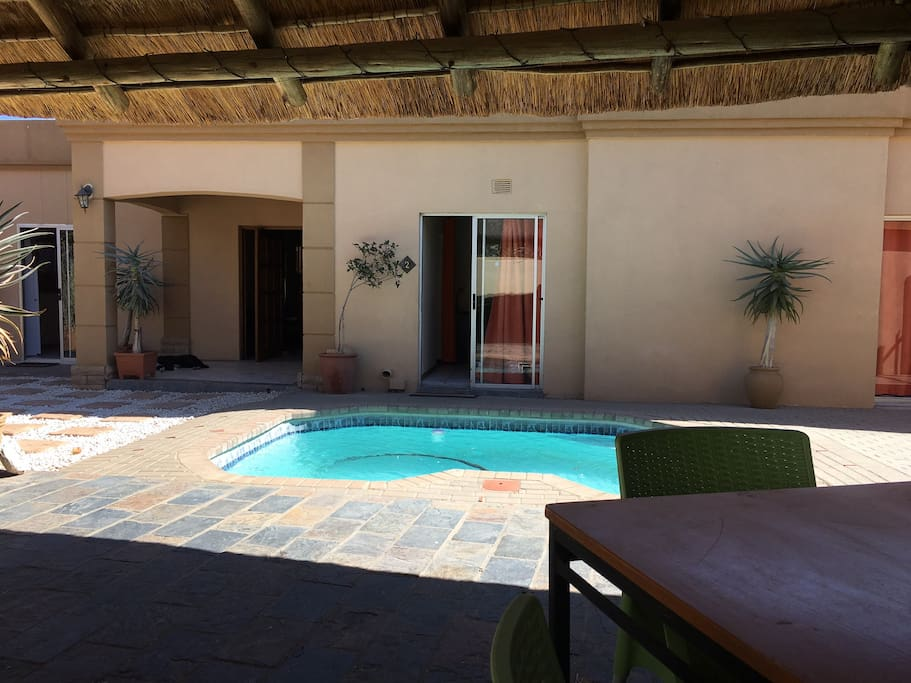 View from Lapa/barbeque area over swimming pool and rooms 1 - 3