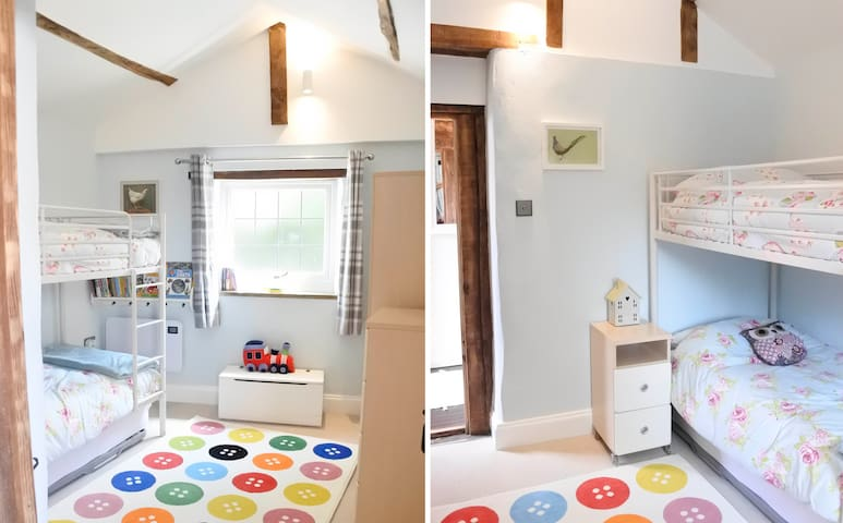 Bright, cheery and full of fun, 'The Henhouse' bedroom offers plenty of space to chill out and play. Easily adapted to suit all ages, from toddlers through to teenagers - and beyond!