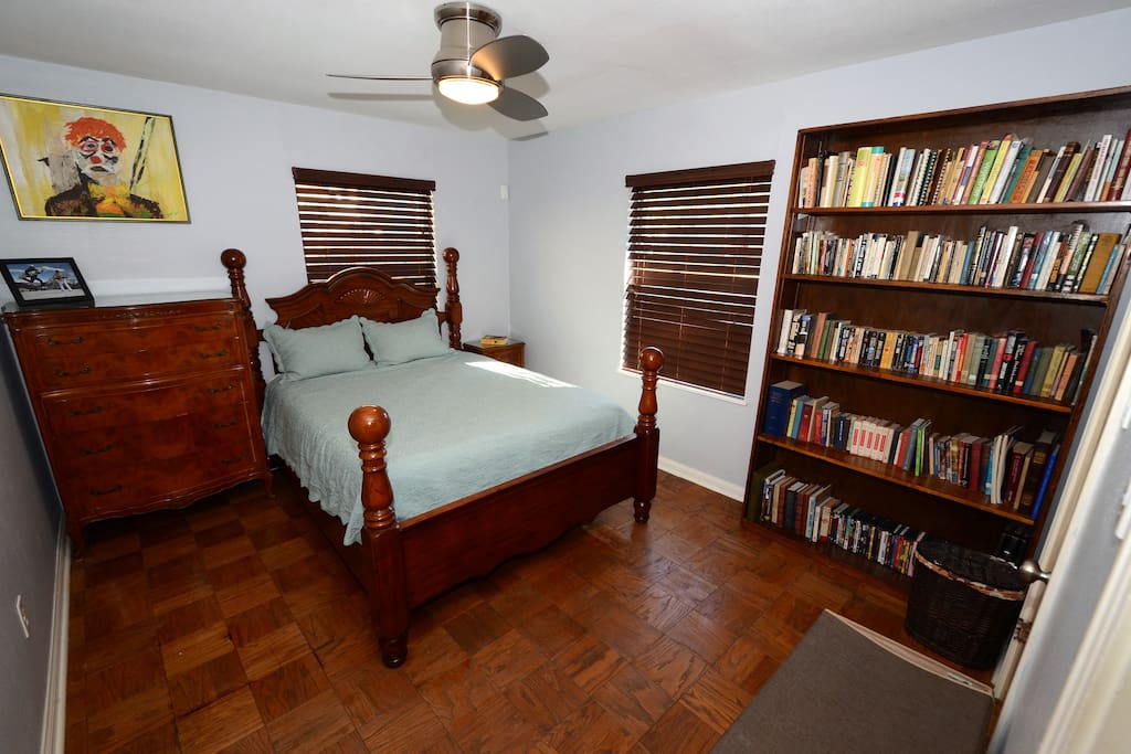 Master bedroom with books for you to relax.