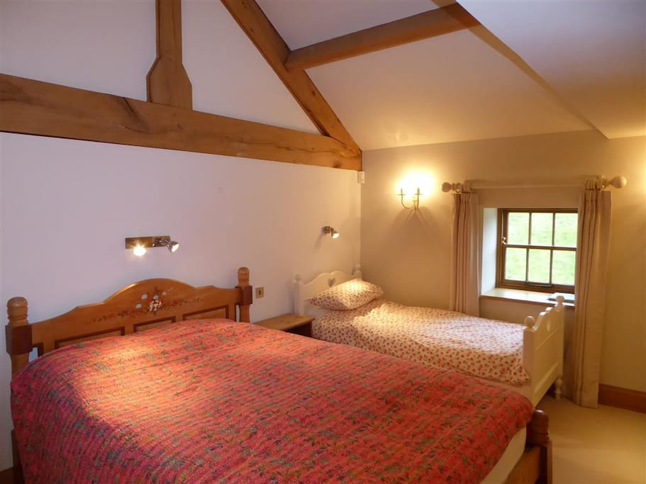 The room has an extra-long (7ft) king sized bed and a single bed