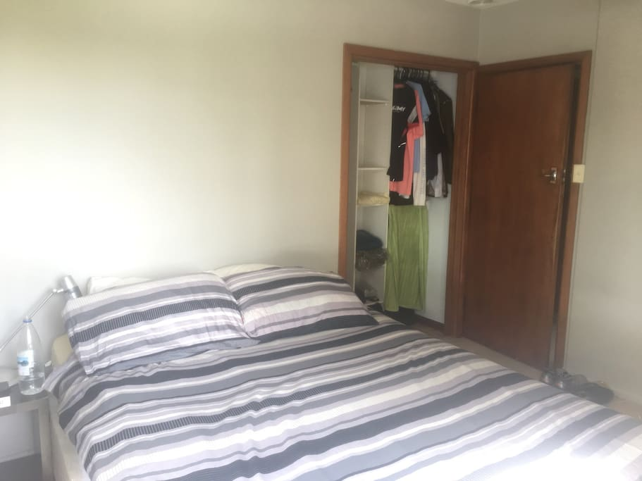 Bed and wardrobe space