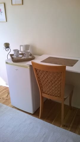 your desk and your private fridge in your bedroom