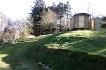 View of the shepherds hut with wooded area in the background.