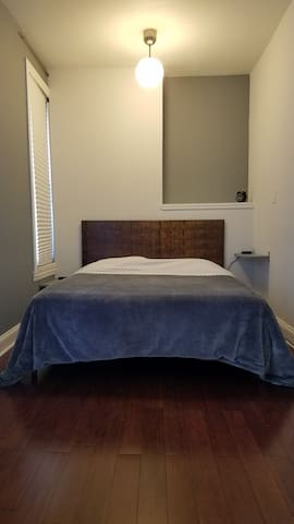 Bedroom with extra pillows and linens provided, and USB plugs on the nightstands.