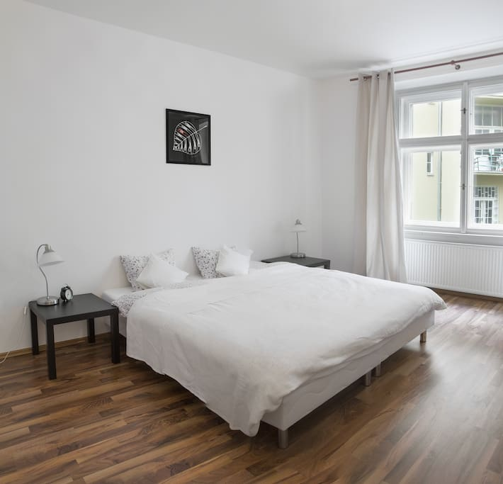 Bedroom with comfy king size bed a windows to inner courtyard.