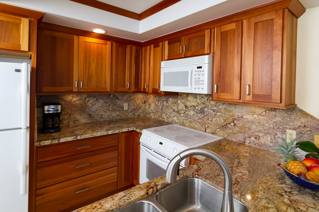Kitchen is fully supplied with large and small appliances. Full granite counters and back splash.