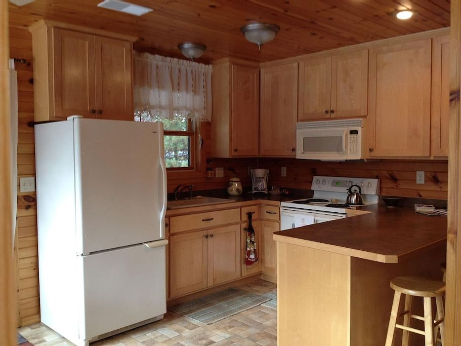 The full kitchen includes cookware, dishes, and pantry.