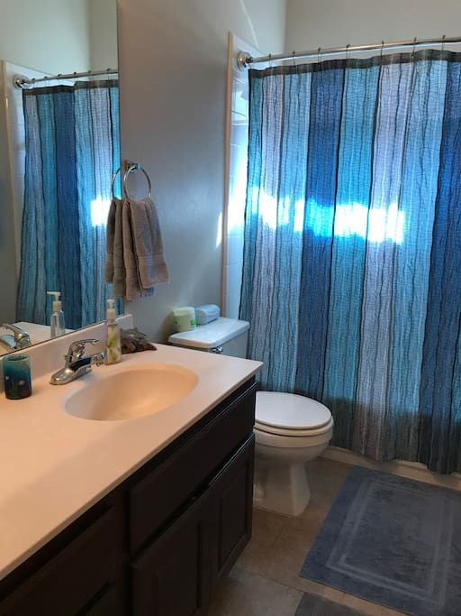 Dedicated bathroom for guest with great counter space.