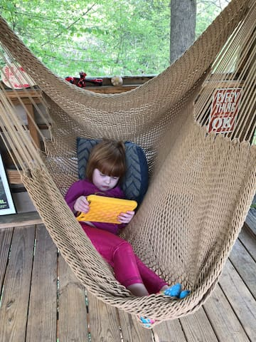 Everyone needs a cozy spot for a break. This little 3 year old is having quiet time in the hammock swing. The treehouse has secure wifi, so stream your favorite shows, scout your adventure for the following day, or share your day's adventure on social media.