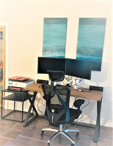 Work area with desk, dual  monitors and printer provided.