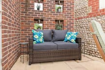 Patio sofa perfect for relaxing with glass of wine, cup of tea or good book.