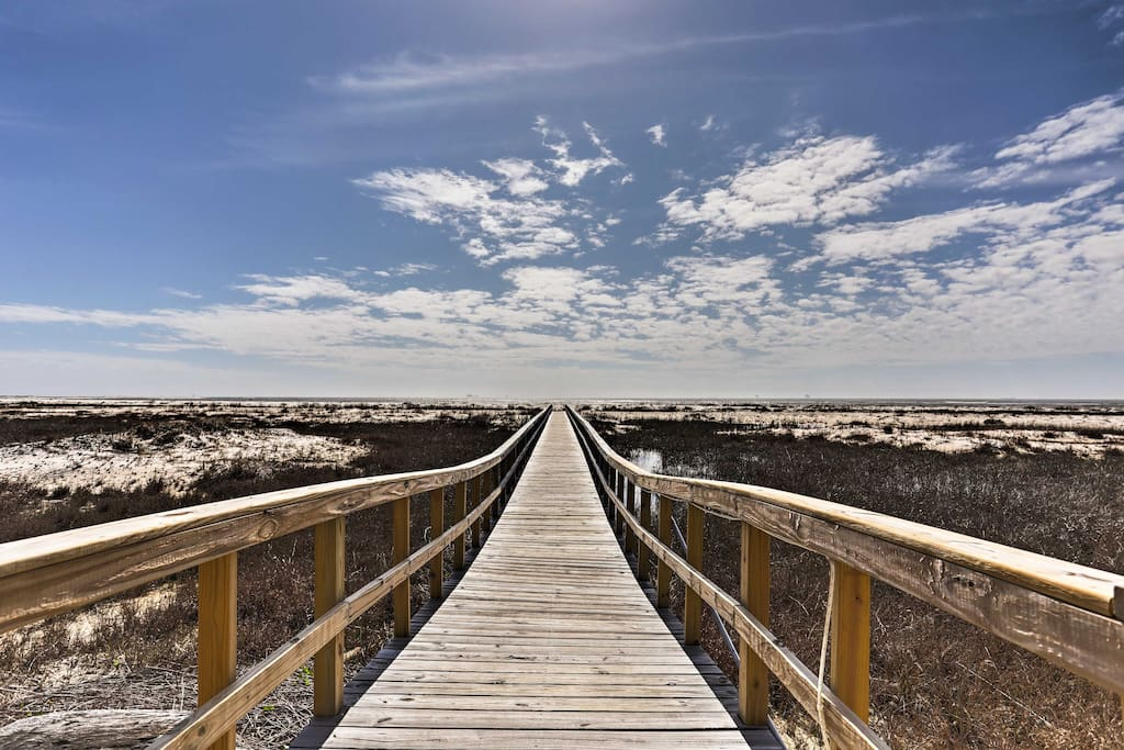 You'll be just a walk over the boardwalk from wide sandy beaches!