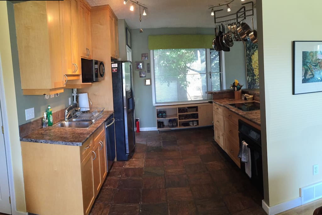 Generous Kitchen with Fridge, Dishwasher, Convection Oven and Cooktop