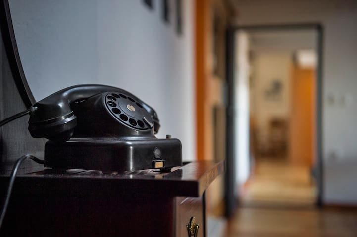An old telephone, a vestige of this apartment's rich past.