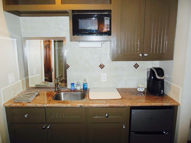 Kitchenette area offers a microwave, dishes, a fridge w/freezer, etc. We also provide a full stocked coffee bar!