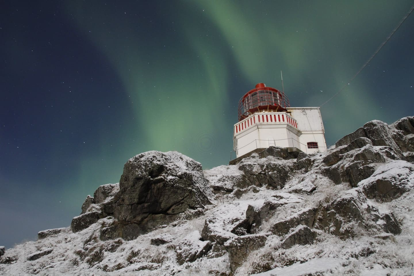 Northern lights over the lighthouse tower. These Auroras can be seen from October until March.
