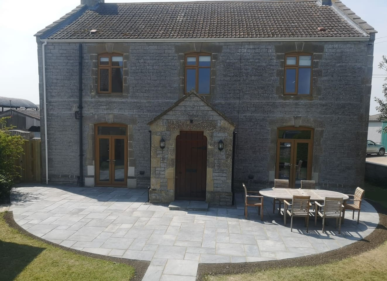 The newly finished patio to the front of The Farmhouse overlooks the tennis court. Both reception rooms have patio doors opening out onto the large patio area, offering the ideal space for indoor/outdoor entertaining.