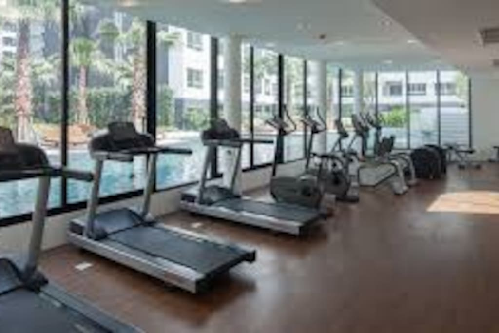 Brand new modern fitness center overlooking the swimming pools