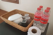 Some bowls, plates, cups and drinking water in each room.