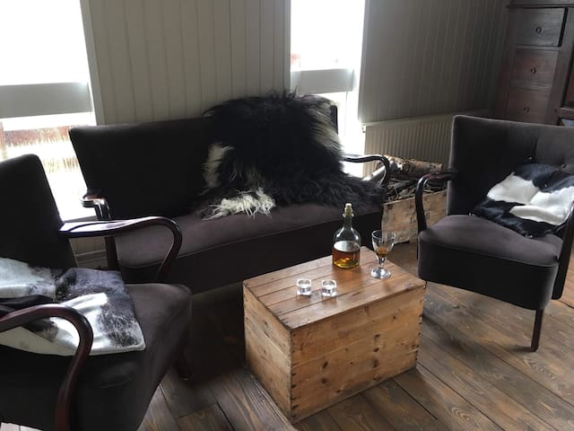 The living room area in the cabin, the fur is Icelandic sheep