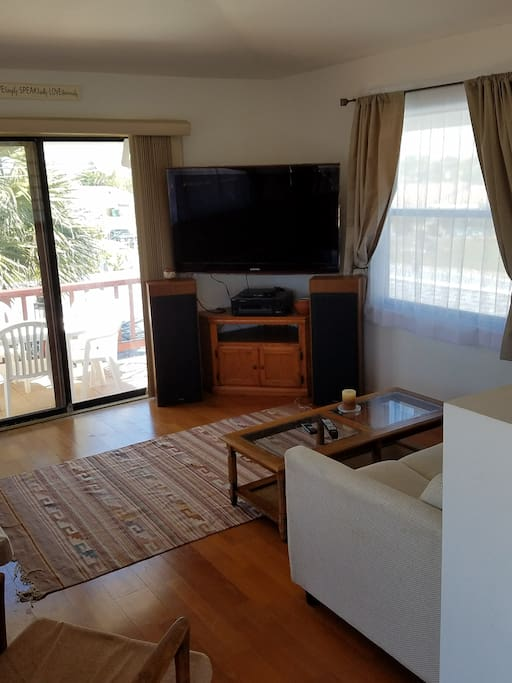 Upstairs living room has a 55-inch TV w/local channels, Netflix & tons of other content. BluRay player with many movies on hand.