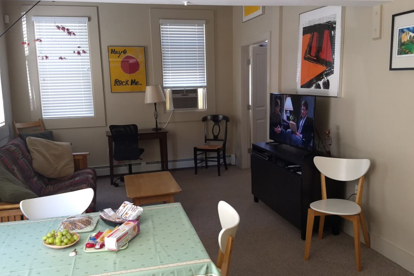 The Living Room – with a futon sofa-bed for two guests... a small desk for laptop use, a table for 4 in the kitchen area and lots of Xfinity TV and hundreds of DVDs from all over the world.