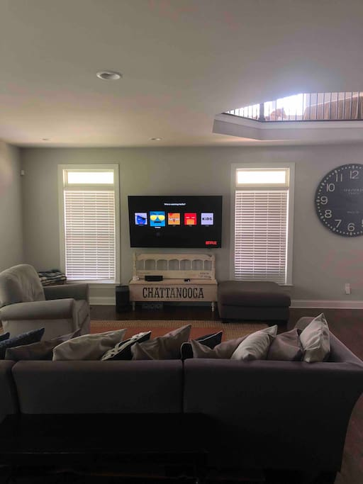 """Living room with 70"""" TV. Netflix. Showtime. Hulu. Amazon Prime."""
