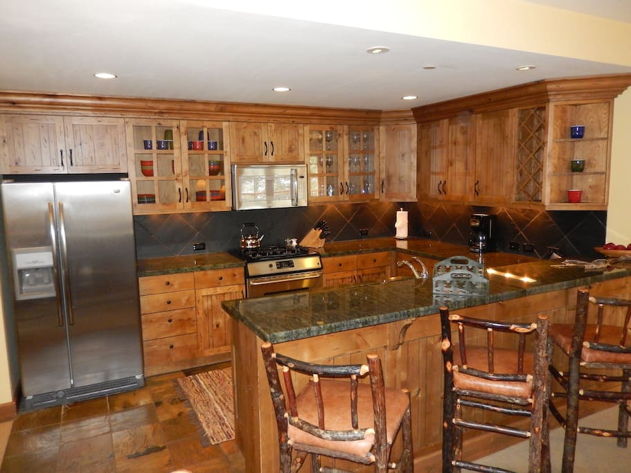 Suite comes with fully-equipped gourmet kitchen with granite countertops and stainless steel appliances.