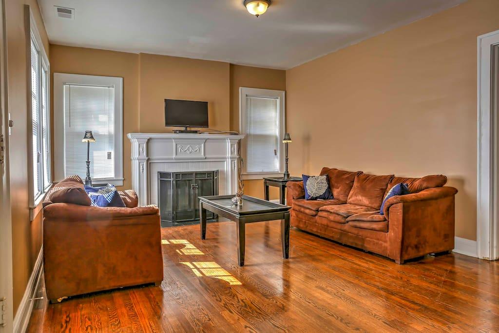 Step into the living room with plush sofas, flat-screen cable TV, and a wood-burning fireplace for those chilly nights.
