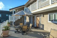 Spacious sunny back deck dining area is shared with other condo condo owners and guests.