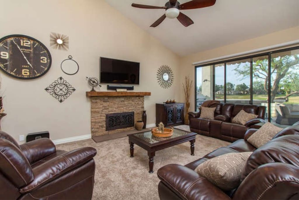 Relax in a spacious front living area...watch the golf tournament from the patio!