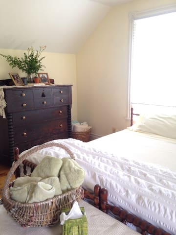 Bedroom #3 is a large bright room with a King size bed and a double bed on a futon frame.