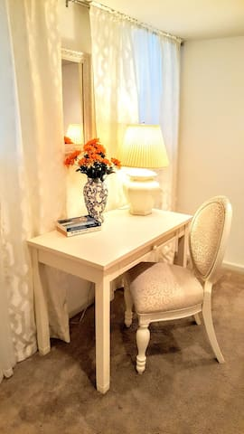 There is a computer-friendly area inside your room! A desk and chair are provided for your convenience.
