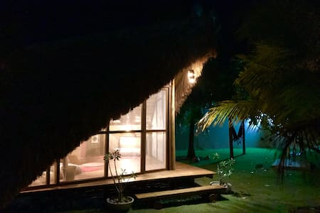 Glamping on tropical garden. Beach village.