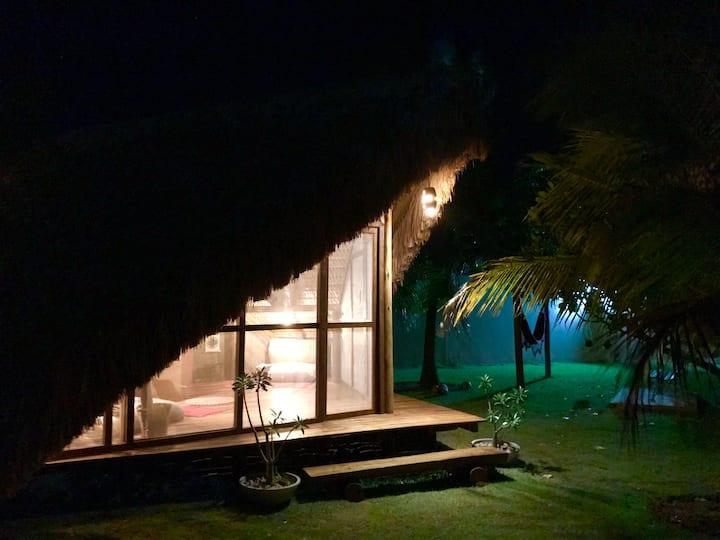 Glamping on tropical garden. Beach village.