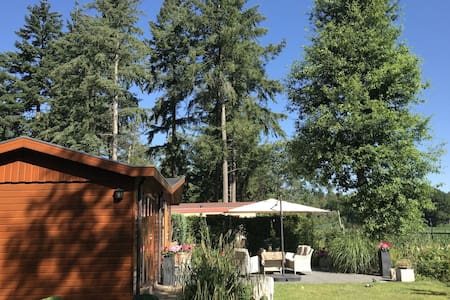 Chalet in holiday park with spacious living room, large enclosed garden and unobstructed view