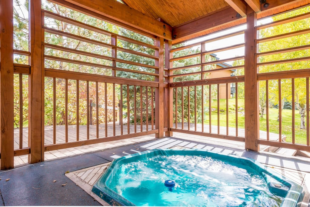Relax in the shared outdoor hot tub.