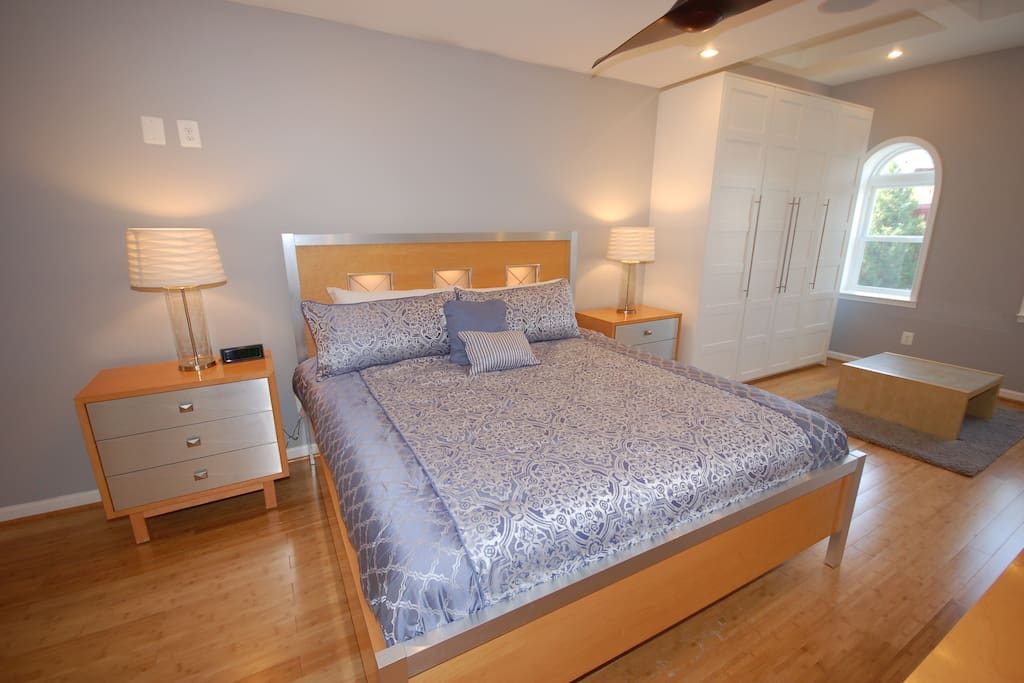 Master Bedroom, furnished with a king size bed. This bedroom is located on the 3rd floor