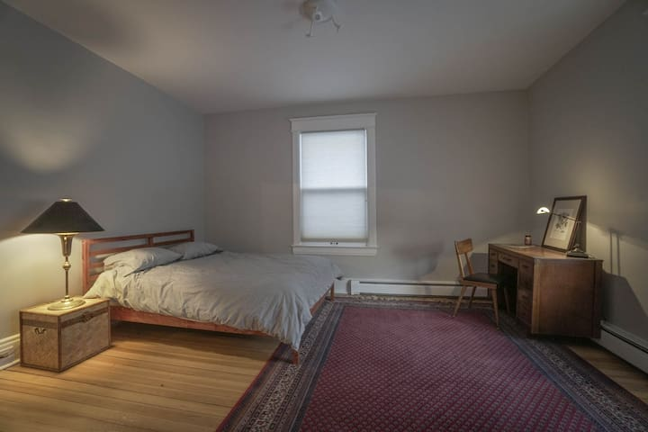 Guest bedroom in historic home near Grand Ave.
